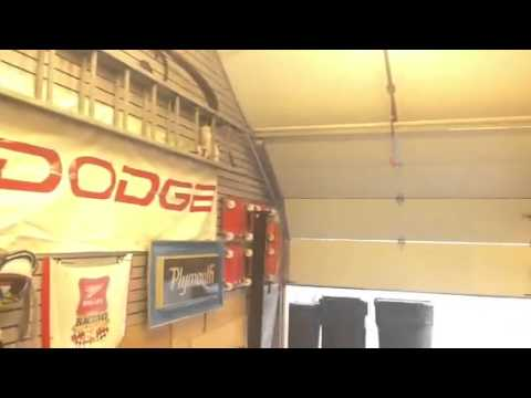Roof pitch garage door modification youtube for Garage modification