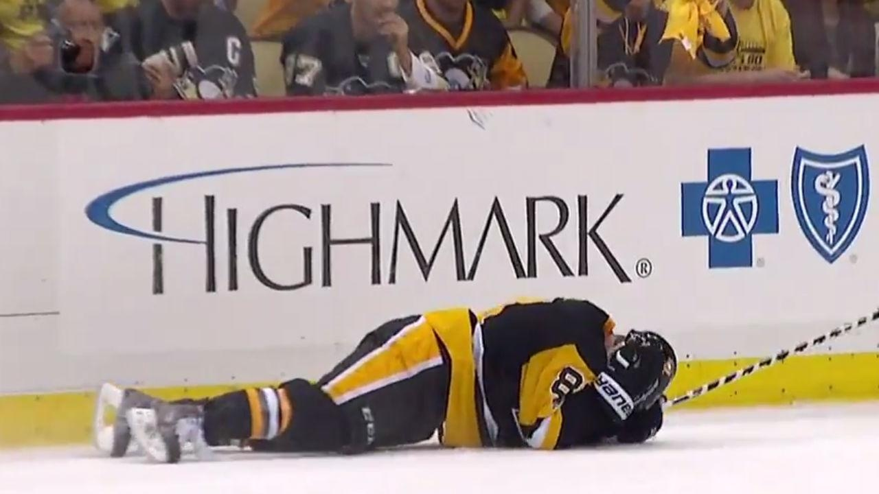 Kessel gets hit in the head with a puck by teammate\'s clearing ...
