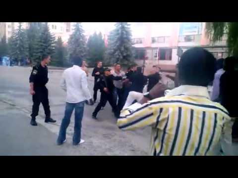 Ukraine Policemen Join Citizens Brutalizing Africans