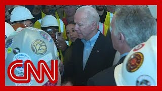 Joe Biden confronted on gun control by auto plant worker