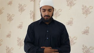 Muslim man seeking prayers from Allah while wearing kufi and a traditional dress