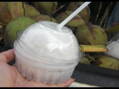 How to peel off a fresh coconut in Chiang Mai, Thailand