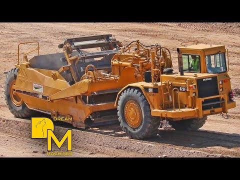 CATERPILLAR SCRAPER + GRADER LEVELING ROUGH TERRAIN & MOVING DIRT