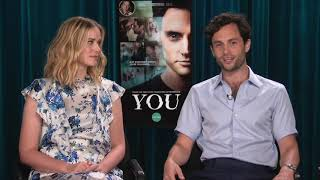 Penn Badgley & Elizabeth Lail talk about working with John Stamos on YOU