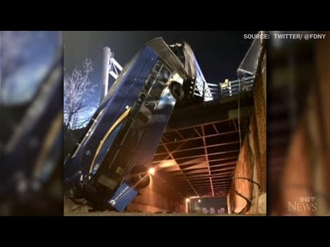 NYC bus dangles precariously from overpass after crash