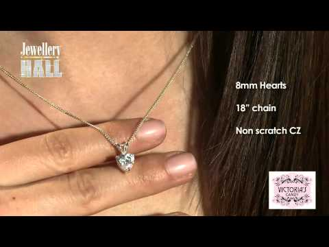 CZ Heart Pendant And Earrings Set In Sterling Silver