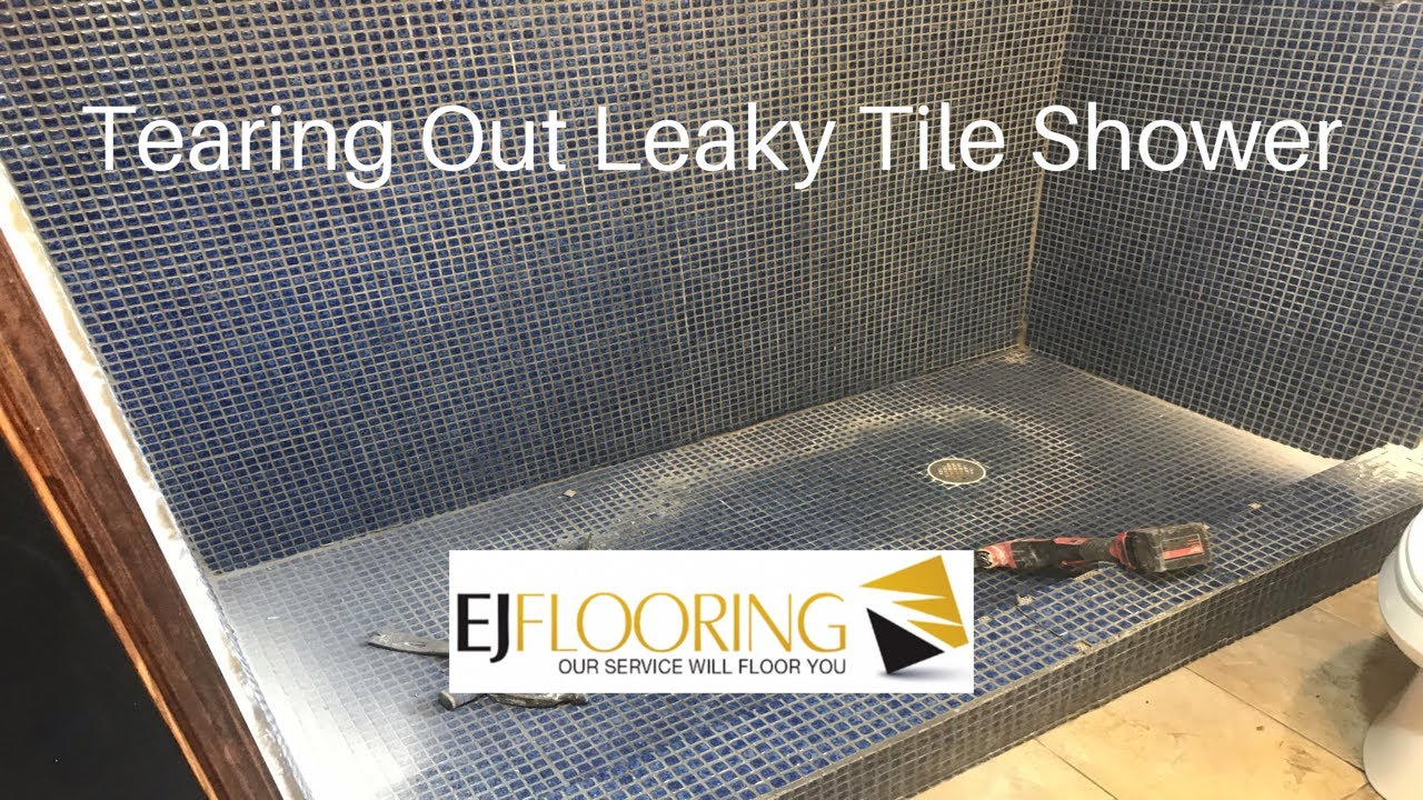 tearing out a leaking tile shower