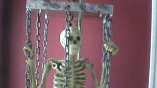 Mini Life Size Animated Hang Up Caged Skeleton www.doll-lovers-paradise.com