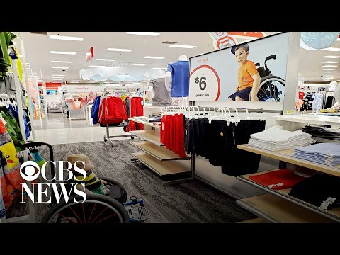 Boy in wheelchair stares in awe at Target ad that features a boy just like himself