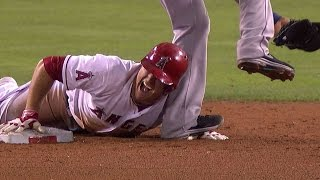 SEA@LAA: Trout gets spiked on the hand during slide
