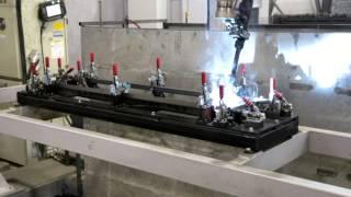 Робот делает прицеп(Сварочный робот делает рамку борта для курганского прицепа Крепыш http://pricep45.ru/catalog/show/6. При изготовлении..., 2015-08-28T07:23:02.000Z)