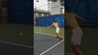 Tennis forehand inside out by Taentawan Taddeo