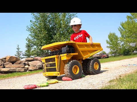 4 year Old MOE RIDES a 300lb DUMP TRUCK vs WHOOPEE CUSHIONS | RC ADVENTURES