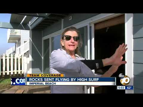 Rocks sent flying by high surf in Imperial Beach