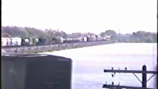 1989 cnw business train w f units meets a freight wmv