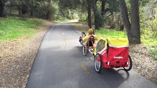 Handcycle pulling a Yakima bike trailer