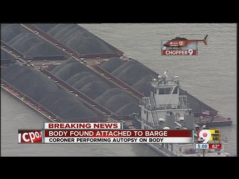 Body wedged between two coal barges in Ohio River