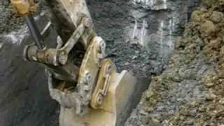 Video still for Leading Edge Attachments Hi-Cap Multi-Ripper Bucket on Cat 385