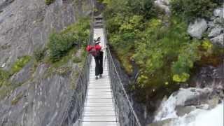 Crossing A Suspension Bridge Over A Torrent Below Glacier De Bionnassay, Tour Du Mont Blanc