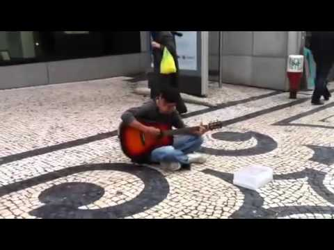 Street Musician (Kurt Cobain?) is singing Civil War of Guns N' Roses