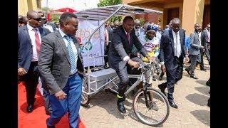 President Uhuru and Ruto RIDE Solar e-Cycle made in Kenya!!!