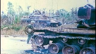 US 1st Infantry Division soldiers check a destroyed M-48 Patton tank on a road in...HD Stock Footage