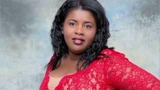 Do you know her ? Meet Madelange Laroche Haitian Designer