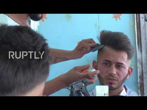 Iraq: Teenager who fled IS opens up barber shop in Erbil's IDP camp