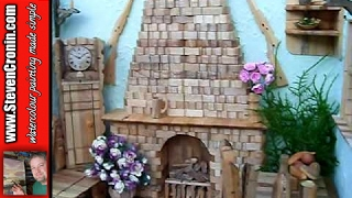 Model cottage made from wooden pegs