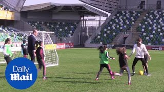 William and Kate go head-to-head on football pitch