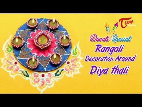 Diwali rangoli decoration around diya thali creative for Diya decoration youtube