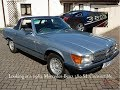 Looking at a 1982 Mercedes-Benz 380SL Convertible in Silver Blue Metallic