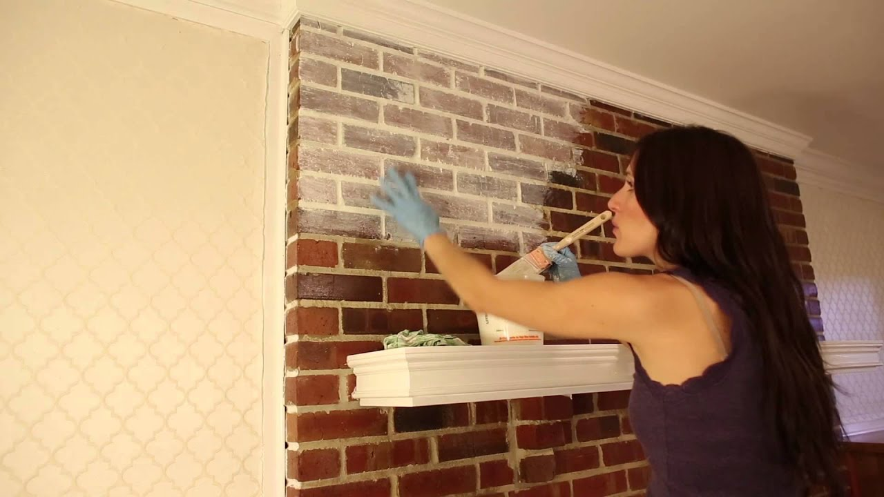 Video tutorial on how to whitewash a brick fireplace and give it that distressed finish; a very shabby chic finish. Very light