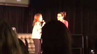 Millie Bobby Brown singing with a fanatic