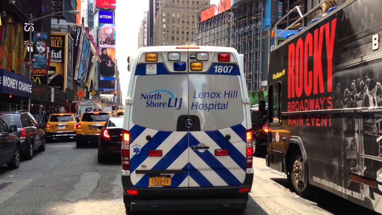NORTH SHORE LIJ LENOX HILL HOSPITAL EMS AMBULANCE RESPONDING ON 7TH AVE  IN  TIMES SQUARE, MANHATTAN