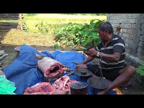 Villagers cutting pork