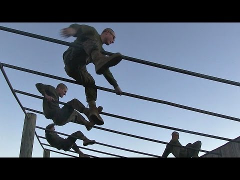 Marine Recruits Muscle Through Parris Island Obstacle Course