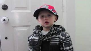 Little Boy Pretending He Is A Race Car Driver