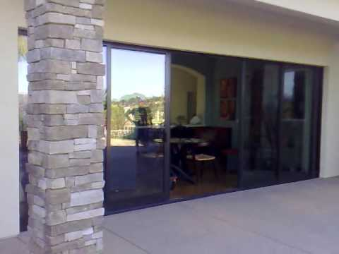 Automatic sliding glass doors into pocket frames youtube for Pocket sliding glass doors