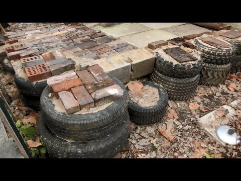 Random Bits 0151: building a foundation with Tires, Bricks, and Sand for my scrapheap