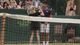 Djokovic Makes a Great Ball Girl!