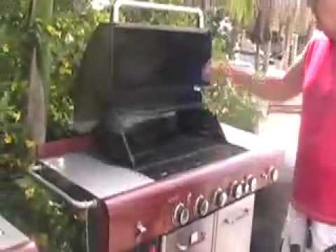 Cleaning the barbecue grills by Don McKay.mov
