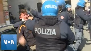 Protesters Fight with Police Outside of Rome Prison