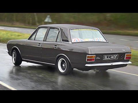 Classic Cars leaving a Car Show in the Rain - January 2017