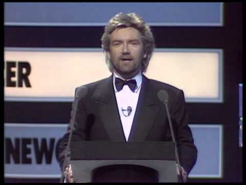 Stock, Aitken & Waterman win British Producer presented by Trevor Horn | BRIT Awards 1988