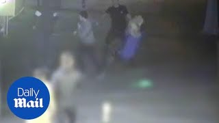 Cowardly man knocks woman out outside McDonald's