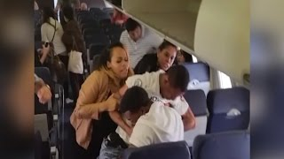 Watch Flight Attendant Get Caught in Middle of Brawl on Southwest Flight