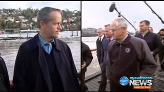 Both leaders flew to Tasmania to survey the flood damage