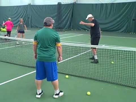 TJ being shown how to do a backhand volley better 2018 A3