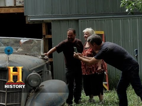 American Pickers Bringing A Classic Car Into The Light Of Day